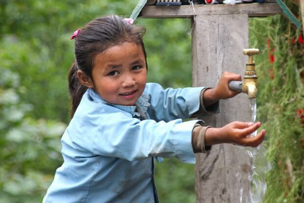 The cummunity water tap - all children wash their face here before going to the school