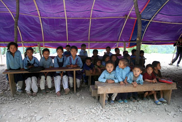 This was how the classes were taken, in the open, under tarpauline - well soon the classrooms with the tin roof and bamboo walls will be completed